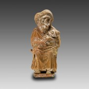 Greek Terracotta Statuette of a Grotesque Nurse and her BabyGreek Terracotta Statuette of a Grotesque Nurse and her Baby