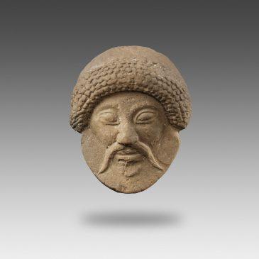 Mask-Applique representing a Male Head